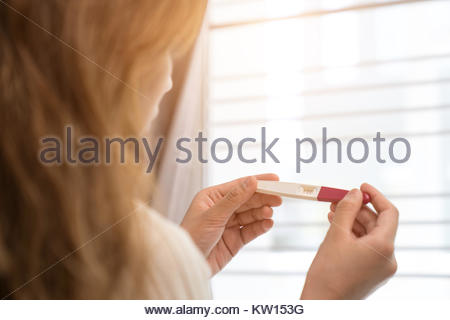 Woman holding pregnancy test, New life and new family concept. - Stock Photo