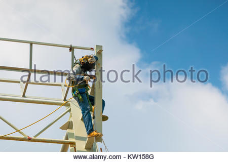 In the construction site, the welding workers at work Concept Work on high - Stock Photo