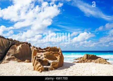 big granite rocks on seychelles beach, petite anse, la digue - Stock Photo