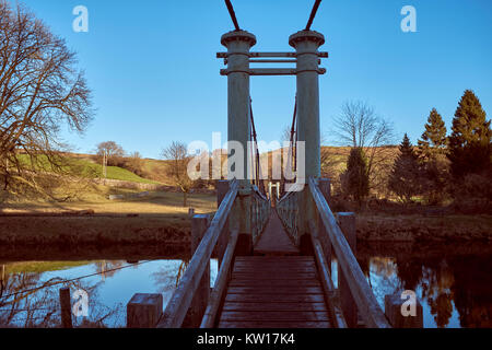 Renovated narrow footbridge over River Wharfe by Burnsall. Wharfedale, North Yorkshire. Donations Eileen King in - Stock Photo