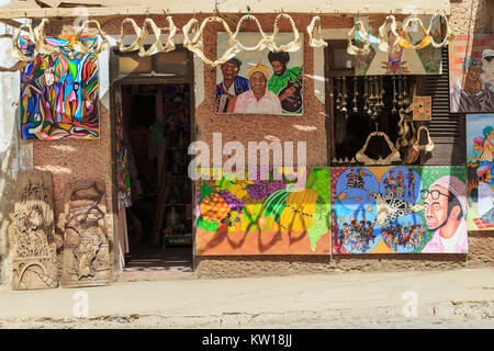 Local souvenir shop selling paintings and sharks jaw bones to tourists, Santa Maria, Sal, Salina, Cape Verde, Africa - Stock Photo