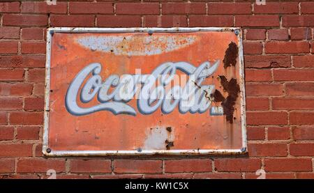 Oklahoma, Usa - July 20, 2017: Sign of Coca-Cola painted in a rusty and old metal. Coca-Cola is a carbonated soft - Stock Photo
