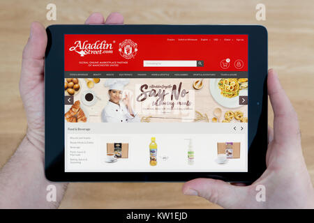 Manchester united icon logo stock photo 131252527 alamy a man looks at the aladdin street website on his ipad tablet device shot against voltagebd Gallery