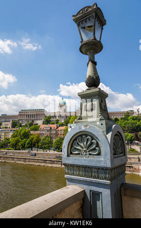 The iconic Buda Castle, viewed over the River Danube from the Szechenyi Chain Bridge with typical lamp post, Budapest, - Stock Photo