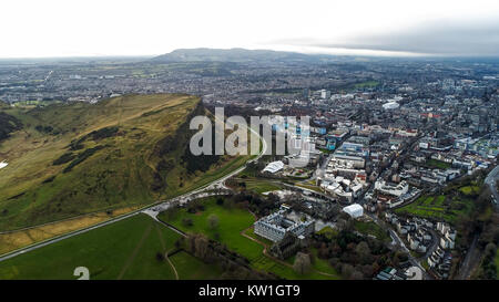 Aerial View Flying by Iconic Landmarks in Edinburgh Famous Arthur's Seat Hill, Modern Scottish Parliament Building, - Stock Photo