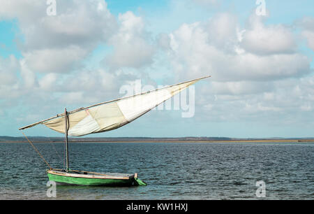 Traditional sailing boat off the coast of Tofo Beach in Mozambique. - Stock Photo