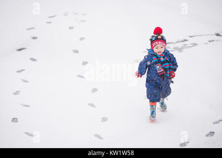 Mossley, UK. 29th Dec, 2017. Three year old Luke Wilkinson plays in the snow in the Pennine village of Mossley, - Stock Photo