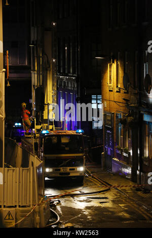 Manchester, UK. 30th December, 2017. A fire officer stood on top of a fire engine attending a fire on the 10th and - Stock Photo