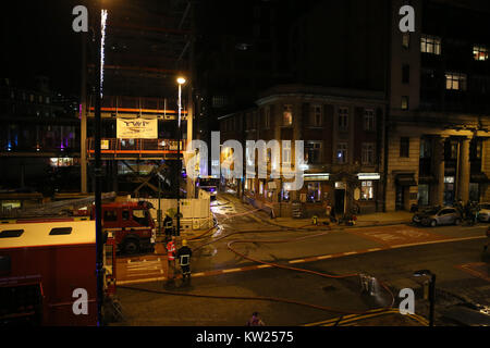 Manchester, UK. 30th December, 2017. Emergency services attend a fire on the 10th and 11th floors of an apartment - Stock Photo