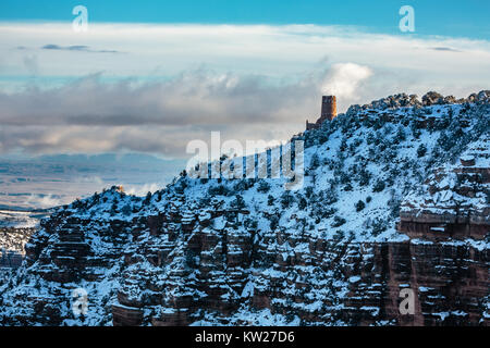 The Desert View Trading Point is visible from Navajo Point on a Wintry early morning at the Grand Canyon. - Stock Photo
