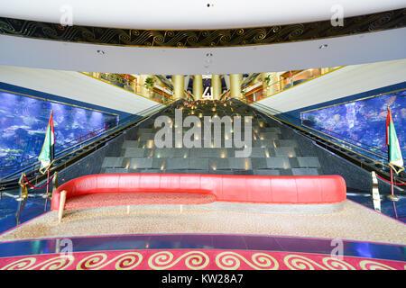 Dubai, UAE - November 25, 2012: Interior of the Burj al-Arab, in Dubai, UAE. The Bur is the most exclusive hotel - Stock Photo