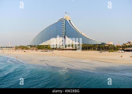 Dubai, UAE - November 25, 2012: Jumeirah Beach Hotel in Dubai. This wave-shaped hotel complements the sail-shaped - Stock Photo