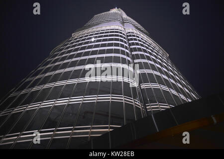 Dubai, UAE - November 25, 2012: Vertical view of the Burj Khalifa the highest tower in the world in Dubai, United - Stock Photo
