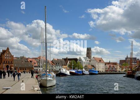 Wismar, town view of the old harbour with water gate and steeple Saint Marien , Stadtansicht vom Alten Hafen mit - Stock Photo