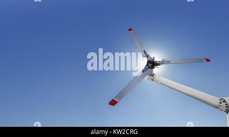 Closeup of helicopter tail rotor blade mechanism against blue sky - Stock Photo