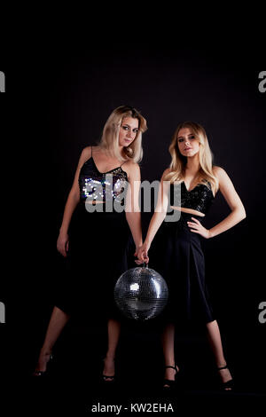 beautiful mother and daughter portrait in Studio on black background. Look great. Professional make-up. Dancing - Stock Photo