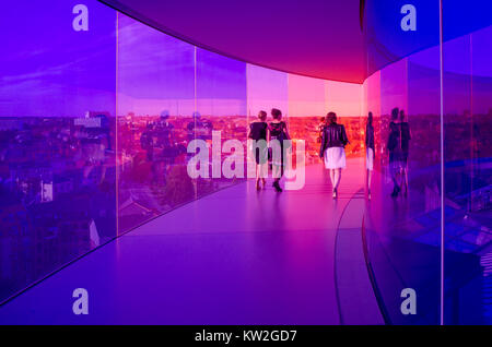 Visitors enjoy the Rainbow panorama of Aarhus at Aros Art Museum. The museum is the second most visited in Denmark. - Stock Photo
