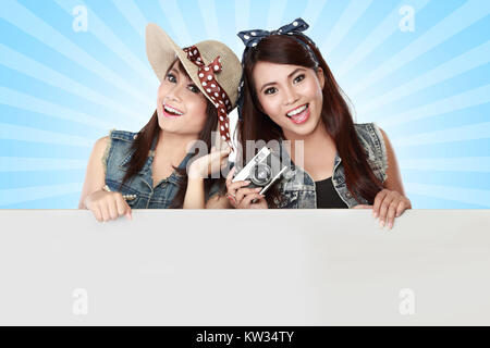 two young girl holding blank white board - Stock Photo
