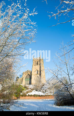 St. Mary's Church, Kidderminster, Worcs on a bright sunny morning with snow on the ground. - Stock Photo