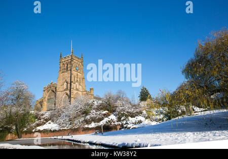 St. Mary's Church, Kidderminster in snow. Bright sunny morning, snow on ground, canal in foreground & vivid, blue - Stock Photo