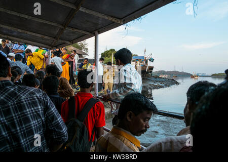 Mumbai's people travel from versova to Madh using this makeshift boat. Madh being cheaper finds itself home to many - Stock Photo