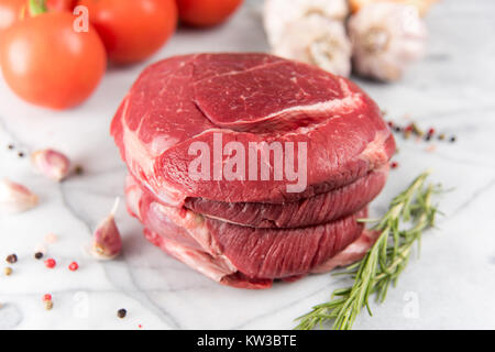 Raw Grass-Fed Beef Roast on Kitchen Counter Ready for Seasoning - Stock Photo