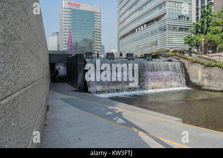 Starting point of Cheonggyecheon Stream in Cheonggye Square, with modern buildings, a colorful spiral sculpture - Stock Photo