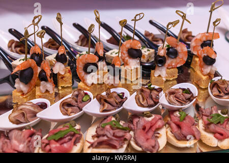 Shrimp with olives, cheese with grapes and canapes with meat. Cocktail Reception - Stock Photo