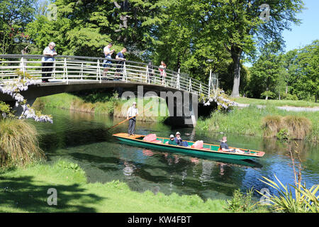 Footbridge over the Avon River in Christchurch, Canterbury, South Island, New Zealand with people on the footbridge - Stock Photo