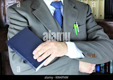 An concept Image of a Manager in a library - Stock Photo