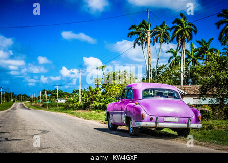 American Chevrolet classic car parked on the highway in Santa Clara Cuba - Serie Cuba Reportage - Stock Photo