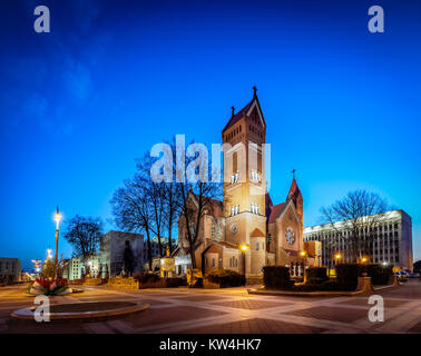 Church of saint Simon and Helena also know as the red church is a Roman Catholic church on Independence Square in - Stock Photo