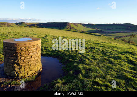 Low Winter Sun on Sumit of Cadbury Castle with Corton Hill & Whitcombe beyond - Stock Photo