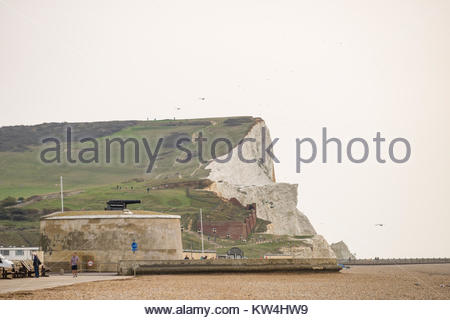 Martello Tower number 74 in foreground now home of the Seaford Museum with the white cliffs of Seaford Head rising - Stock Photo