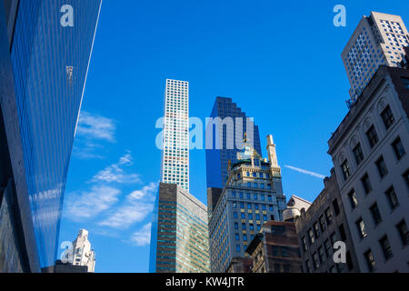 Old and new New York skyscrapers seen along 57th Street in Midtown Manhattan - Stock Photo