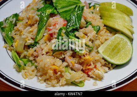 fried rice with Chinese kale and pork on plate - Stock Photo