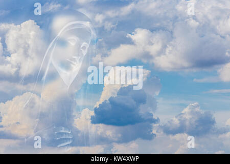 The Medjugorje Blessed Virgin Mary on white clouds on bright blue sky - Stock Photo