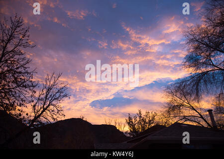 Cloudy sunrise over Wasatch Mountain front in Provo UT - Stock Photo