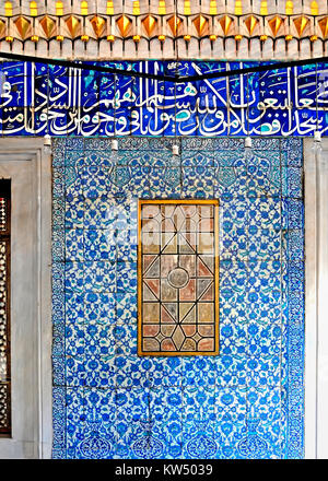 DECEMBER 30,2009 ISTANBUL TURKEY.Ancient Ottoman patterned tile composition with some verses in Arabic from Holy - Stock Photo