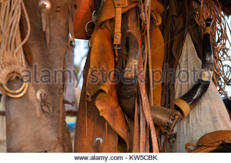 Chaps and cow horn trumpets on a cattle ranch in the Brazilian Pantanal. - Stock Photo