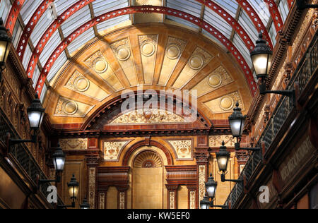 The sunlit Central Arcade, Newcastle Upon Tyne, showing the elaborately decorated end wall and the iron and glass - Stock Photo