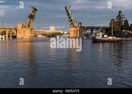 Tugboat going through the Univaerstiy Drawbridge, Seattle, Washington, USA - Stock Photo
