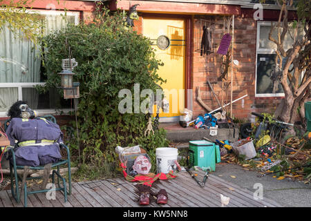A House With Halloween Decorations In The Front Yard.   Stock Photo
