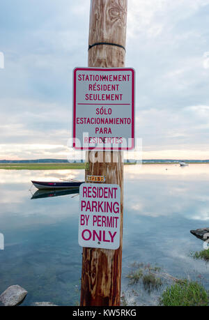 Trilingual (English, Spanish and French) No Parking Sign... In the Water! - Stock Photo