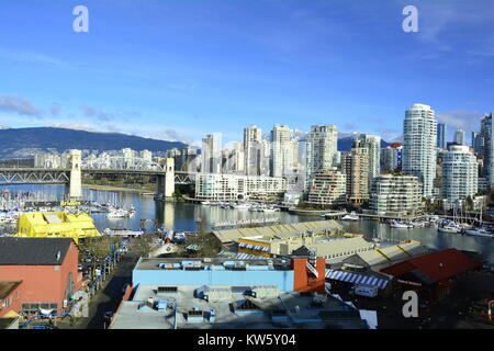 The high rises skyline of False Creek in Vancouver Canada,and Granville Island. - Stock Photo
