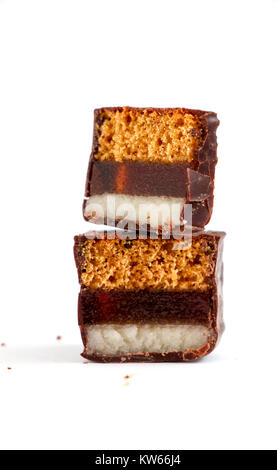 cut chocolate marzipan on white background ,image of - Stock Photo