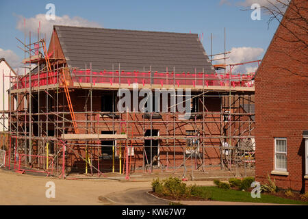 New house covered in scaffolding, Grantham, Lincolnshire, England, UK - Stock Photo