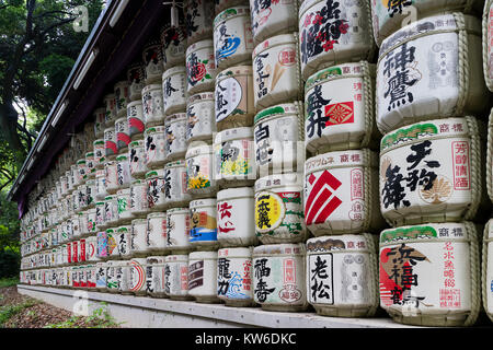 Tokyo -  Japan, June 18, 2017:  Sake barrels donated to the Meiji Jingu Shinto shrine by worshippers of the shrine - Stock Photo
