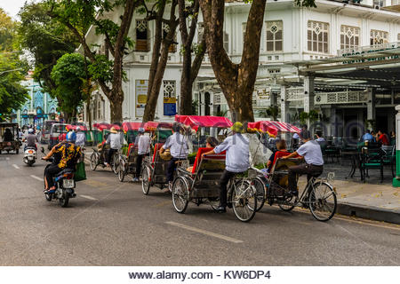 Cyclos (three wheeled bicycle taxis) in the Old Quarter, Hanoi, northern Vietnam. - Stock Photo