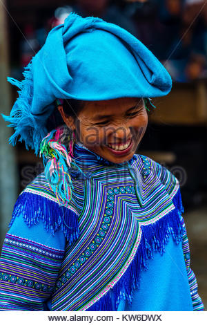 Flower Hmong (hill tribe) woman at the Sunday market at Ba Ha, northern Vietnam. Every Sunday ethnic minorities - Stock Photo